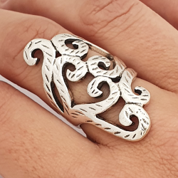 Long arabesque ring